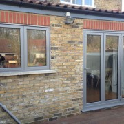 Grey bifold aluminium door