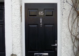 Black composite door with chrome features