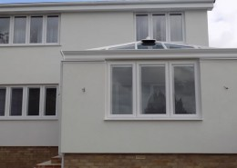 Brick conservatory with white upvc windows