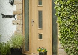 Composite door with glass panels