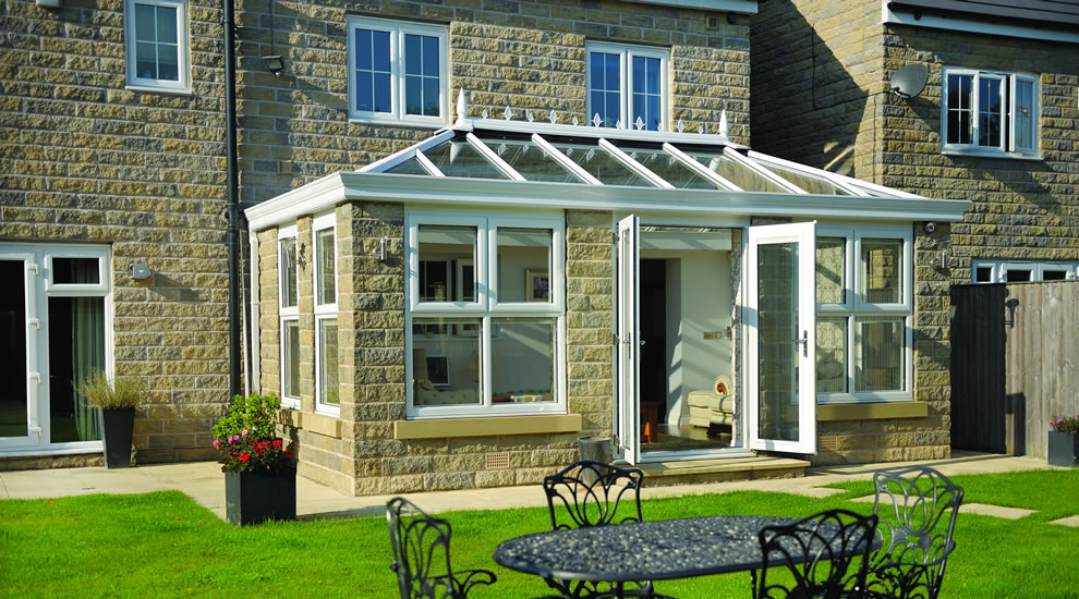 Conservatory installation with white UPVC