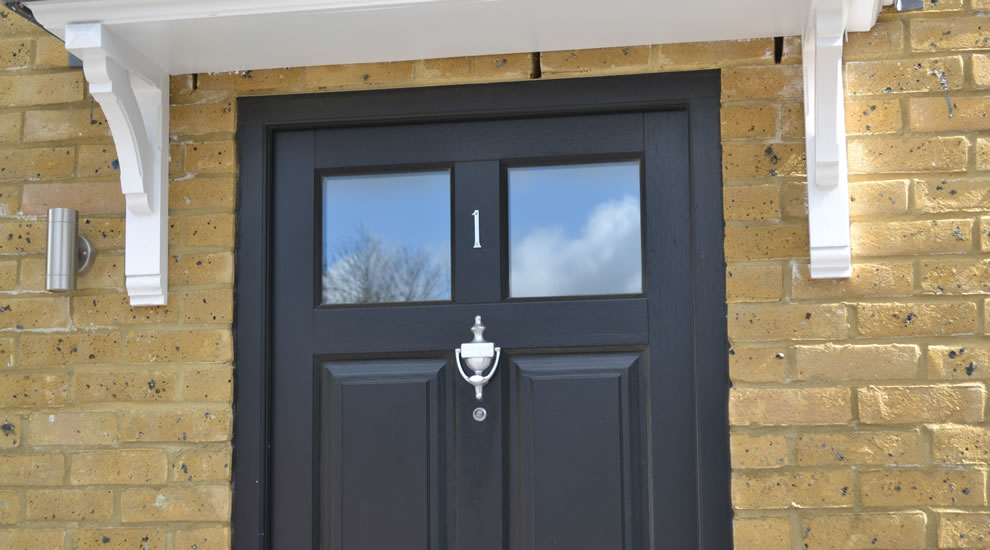 Replacement doors enfield wooden upvc aluminium and for Black wooden front door