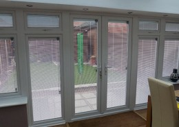 Interior of UPVC conservatory with blinds down