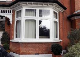 White timber casement bay window