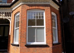 Set of three white timber sash windows