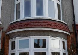 Two white bay timber windows