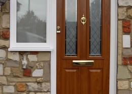 Composite door with wood effect installation