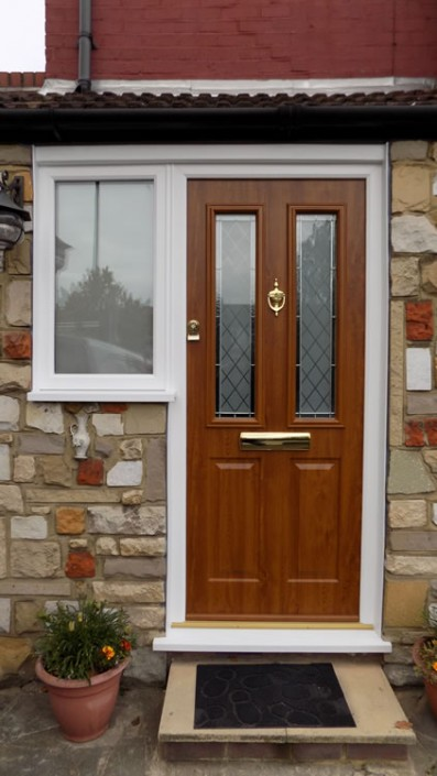 Composite door with wood effect installation