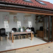 Wood effect UPVC bifold door open