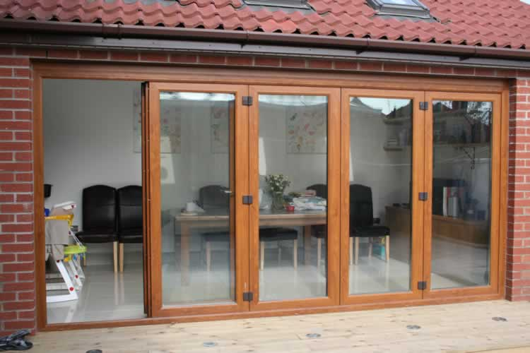 Upvc bi fold doors enfield upvc bi folding doors upvc for Plastic french doors