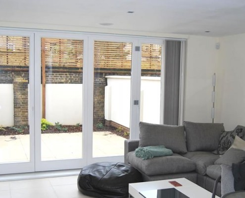 Wooden bi-folds installation