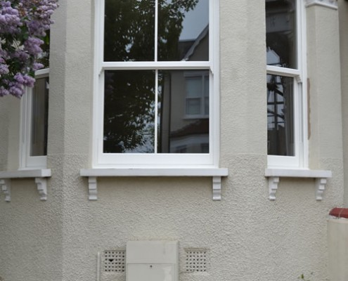 White UPVC bay sash window