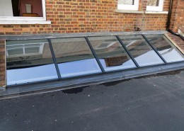 Grey skylight installation in london