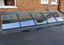 Grey skylight installation in london