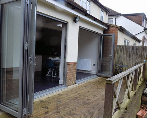 Metallic silver bifold doors open
