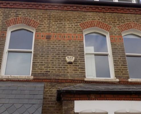 Three white timber casement windows