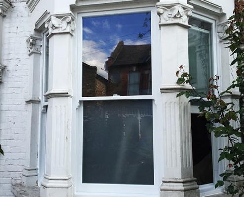 White timber sash bay window