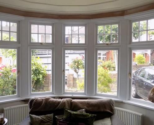 Internal view of white timber bay window