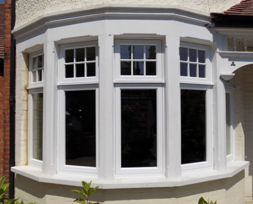 Ground level white timber bay window