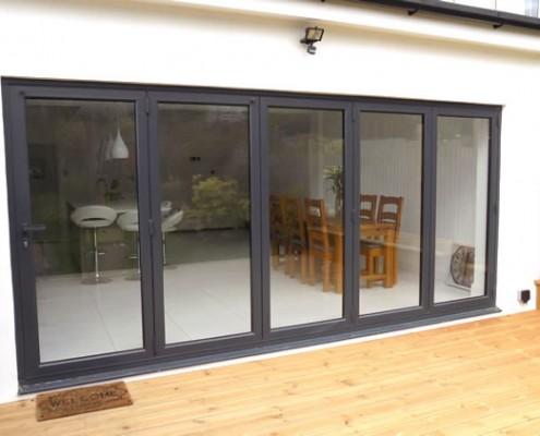 Exterior view of grey bifold doors