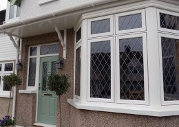 R9 bay window in white with solidor front door