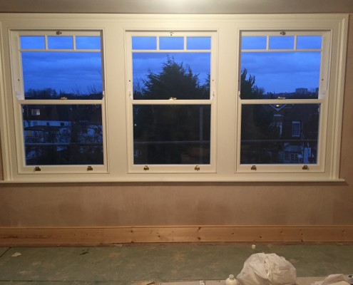 Three white timber sash windows interior