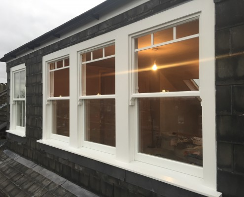 Three timber sash windows exterior