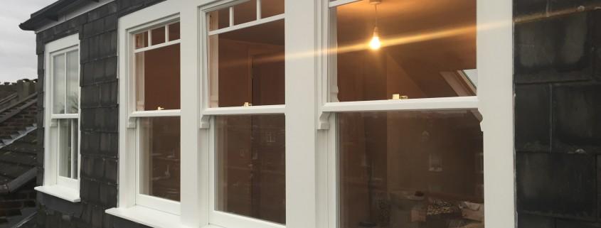 Three timber sash windows exterior