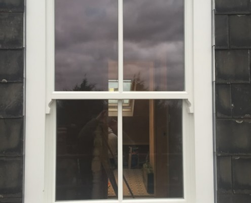 Single white timber sash window