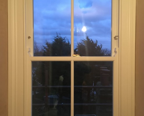 Single white timber sash window interior