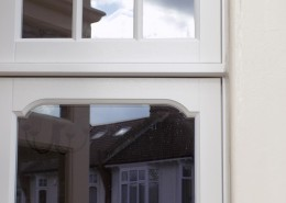 Stepped head detail in timber window