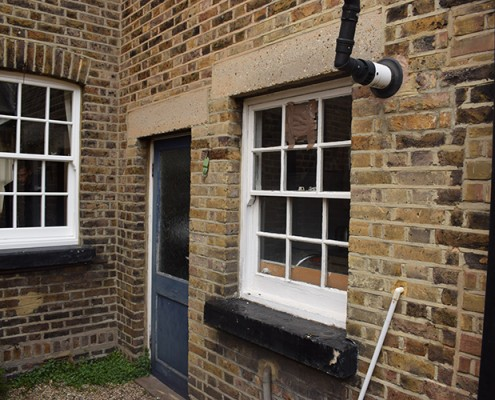 Old timber sash windows at rear