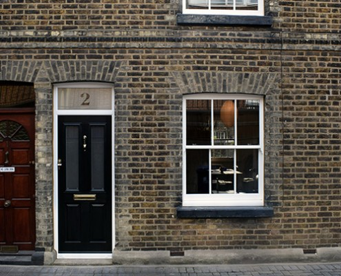 Sash windows and composite door at front