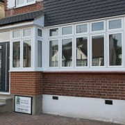White casement front windows