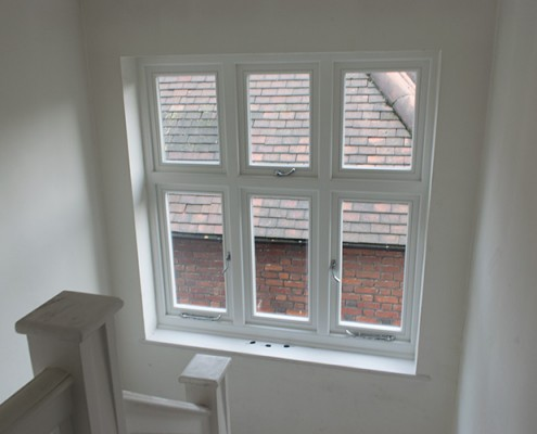 Timber window installation on stairs