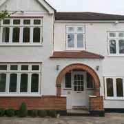 White timber casement window installation in Pinner
