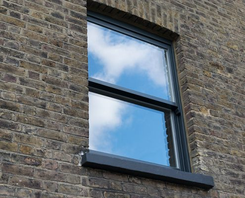 Grey timber sash window exterior