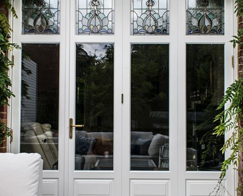 White timber bi-folding doors closed