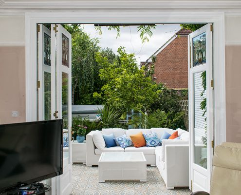 Interior view of white timber bifold doors open