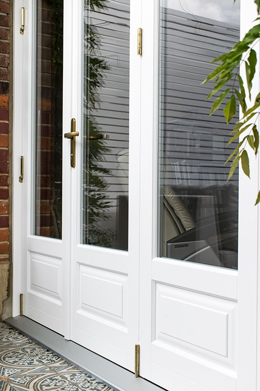 Timber Bifold Doors With Stained Glass Windows In Finchley