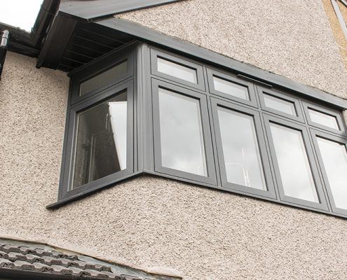 Grey uPVC window installation