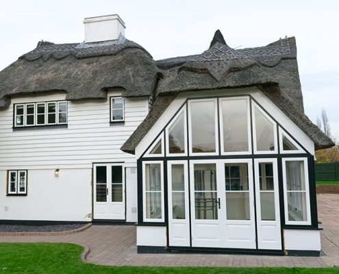 Replacement timber windows and doors in a thatched cottage