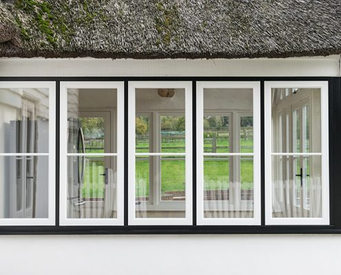 White timber windows in a black frame