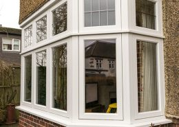 Profile of white timber bay window