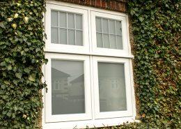 White casement timber window