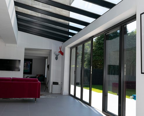 Glass roof over bifold doors