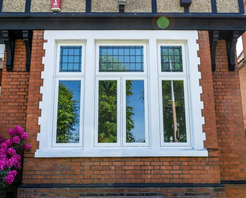 Exterior view of white timber casement windows