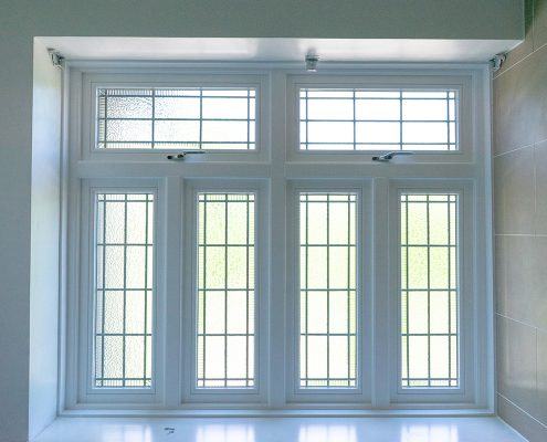 White timber windows with frosted glass