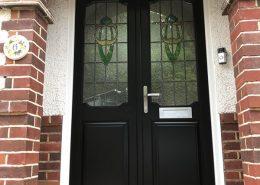 Black timber door within porchway