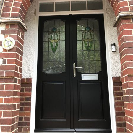 Black timber door within porchway